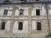 Broken windows on abandoned industrial buildings. Broken window on destroyed and abandoned industrial buildings stock images