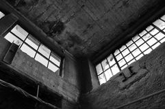 Broken windows concrete wall in derelict factory Royalty Free Stock Photos