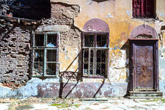 Broken windows of a ruined house. Broken windows, detail of a deserted house Royalty Free Stock Photos