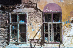 Broken windows of a ruined house. Broken windows, detail of a deserted house Stock Image
