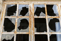 Broken windows in a metal frame Stock Image