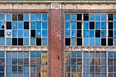 Broken windows on old derelict building Stock Photos