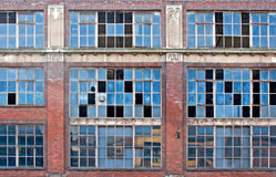 Broken windows on old derelict building Royalty Free Stock Photo