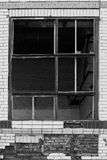 Broken windows in an old industrial building. Black and white Stock Photos