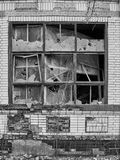 Broken windows in an old industrial building. Stock Photo