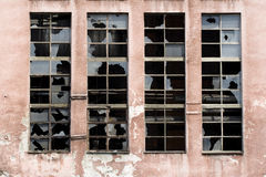 Broken windows on old warehouse Stock Photos