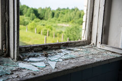 Broken windows with smashed glass Stock Photo