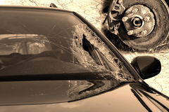 Broken windscreen at black car in traffic accident and disc brake Stock Photography
