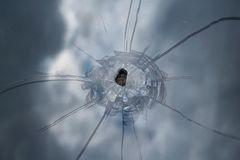 Broken windshield of the car with cracks and chips stock image