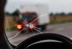 Free Broken Windshield Of A Car. A Web Of Radial Splits, Cracks On The Triplex Windshield. Broken Car Windshield, Damaged Glass With Royalty Free Stock Photos - 155084468
