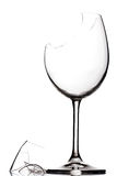 Broken wine glass. Broken crystal wine glass, isolated on white royalty free stock images