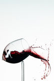 Broken wineglass. Glass of redwine breaks and the wine spurs out Royalty Free Stock Photo