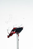 Broken wineglass. Glass of redwine breaks and the wine spurs out Royalty Free Stock Image