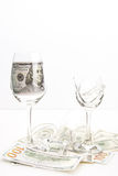 Broken wineglass and money Royalty Free Stock Photo