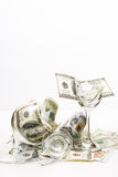 Broken wineglass and money Stock Photos