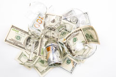 Broken wineglass and money. On white background stock photos