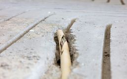 Broken wire in the floor. Installing underfloor heating Stock Image