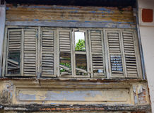 Broken wood louvres window Stock Images