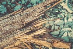 Broken wood lumber vintage art tone. Broken wood lumber with sharp spill in rock background stock photos