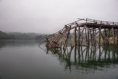 Broken wooden bridge. The end of the wooden bridge Stock Photos