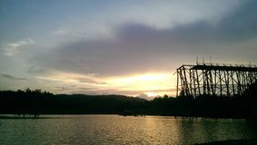 Broken wooden bridge, Thailand. Sunset at Uttamanusorn wooden bridge in Thailand Royalty Free Stock Images