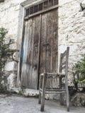 Broken wooden chair at street Stock Photography