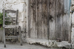 Broken wooden chair at street Stock Images