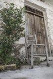 Broken wooden chair at street Stock Photos