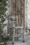 Broken wooden chair at street Royalty Free Stock Photos