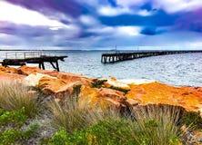 Broken wooden jetty in esperance Western australia. Historical jetty in esperance stock images