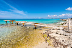 Broken wooden pier Illetes beach Formentera island Royalty Free Stock Photo