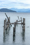 Broken Wooden Pier. A broken wooden pier overlooking the mountains Royalty Free Stock Image