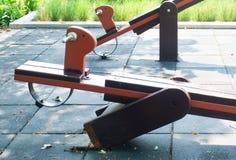 Broken Wooden Seesaw in A Kid Playground Stock Photos