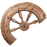 Broken wooden vintage spinning wheel Royalty Free Stock Image