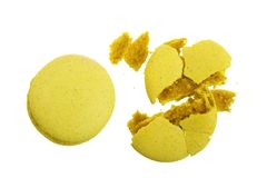 Broken yellow macarons isolated on white background closeup.  Royalty Free Stock Photo