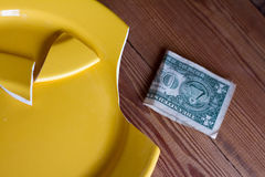 Broken yellow plate - diet or crisis. Royalty Free Stock Photography