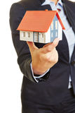 Broker holding house as concept for a home Royalty Free Stock Image