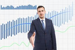 Broker offering handshake as increase in stock market charts. Serious broker offering handshake as increase in business stock market charts with white background stock photography