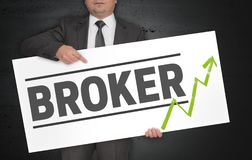 Broker poster is held by businessman stock image
