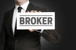 Broker sign is held by businessman Stock Image