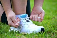 Broker woman tying running shoes Royalty Free Stock Photos