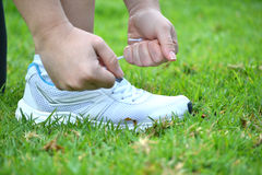 Broker woman tying running shoes Stock Images