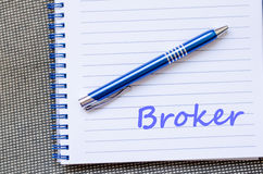 Broker write on notebook Stock Photo