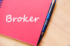 Broker write on notebook Stock Photography