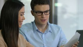 Brokers analyzing stock exchange data, planning company income and spendings. Stock footage stock video