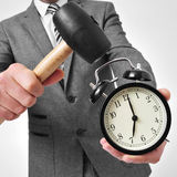 Broking an alarm clock Stock Photos