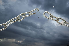 Broking chain on cloudy sky. Royalty Free Stock Images