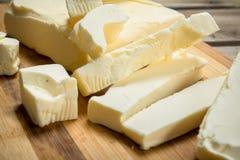 Brokken van boter stock afbeeldingen