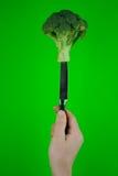 Brokkoli auf einem Messer Stockbild