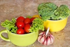 Brokkoli, Kirschtomaten und Knoblauch Lizenzfreie Stockfotografie